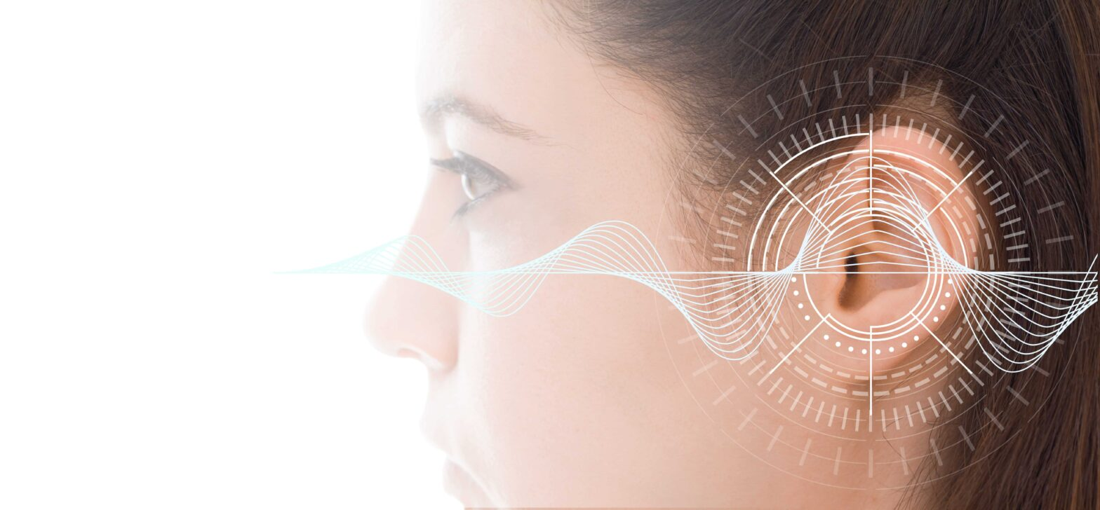 Sound waves over a woman's ears